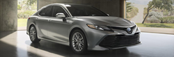 2019 Toyota Camry parked in a showroom