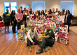 People's Trust Insurance and the Broward Sheriff's Office Help Make the Holiday Season Brighter at the Women in Distress Shelter