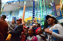 Visitors at The Children's Museum of Indianapolis celebrate together as a family at a family-friendly hour.