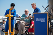 Marvel Comics legend Stan Lee (center), introduces his new superhero, Aviore (left), at EAA AirVenture Oshkosh 2017 on July 28, 2017. At right is EAA CEO/Chairman Jack Pelton.