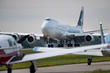 A Cathay Pacific 747-8 cargo aircraft lands at Oshkosh, Wisconsin, for EAA AirVenture Oshkosh 2016. (EAA photo/Jim Koepnick)