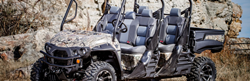 Camouflage Intimidator 4x4 UTV Crew Cab Series on a Rocky Trail