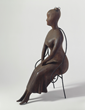 Elie Nadelman, Seated Woman, 1919-25. Cherry wood and iron. Addison Gallery of American Art, Museum purchase Artwork © Estate of Elie Nadelman; photograph, Greg Heins.