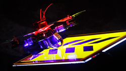 A professional racing drone sits on the starting line, ready to launch