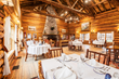Brooks Lake Lodge's all-inclusive experience means three gourmet meals served in a romantic dining hall next to a giant crackling fire is included with comfortable-luxe lodging.