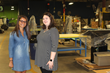 Melissa Tally, Meridian's Marketing Coordinator, and Lily Blake tour the Meridian assembly floor.