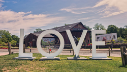 "Visit the ""LOVE"" sign at various locations around Fairfax County this summer."