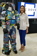 Patty Stoll, Division Manager, Space Systems, with a spacesuit coverlayer designed with Space for Art Foundation