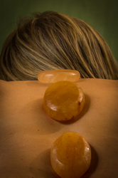 Himalayan salt stones on a woman's back