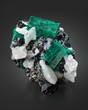 """The Yamile."" Emerald on Calcite, from the Coscuez Mine, Boyaca, Columbia. Formerly in the  Víctor Carranza Niño collection, and currently in the collection of Ms. Lyda Hill. Image by Evan D'Arpino."