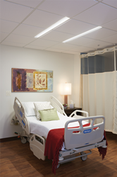 Lenga overbed luminaires in a patient room setting.