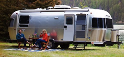 Exterior view of a silver 2020 Airstream International Serenity travel trailer
