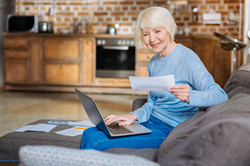 Older woman looking at a financial statement