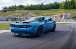 2019 Dodge Challenger SRT Hellcat exterior shot with bright blue paint color driving on a curving country road