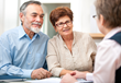 older retired couple meeting with wealth advisor