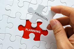 puzzle pieces that have text saying financial planning