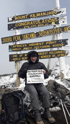 Nat Shaffir on the summit of Mount Kilimanjaro. Photo courtesy Nat Shaffir.