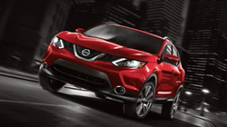 Exterior view of a red 2018 Nissan Rogue Sport
