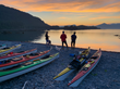 Composers and kayaks on beach at Sunset.