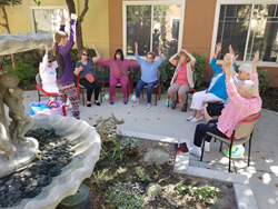 Cypress Place residents exercising with instructor