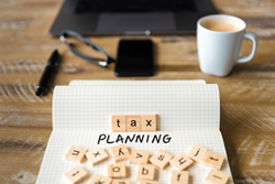 scrabble game pieces that say tax planning