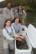 Biologists from the Tennessee Aquarium Conservation Institute acclimate baby Lake Sturgeon for release at Kingston, TN. Clockwise from top left: Ayi Ajavon - Conservation Volunteer, Anna Quintrell - Reintroduction Assistant, Dr. Anna George - VP of Conservation Science and Education, Avery Millard – Aquarist I , Meredith Harris – Reintroduction Biologist.