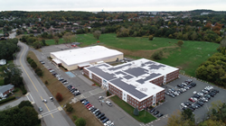 Aerial photo shows the solar energy system on a school's roof