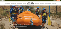 Scouts carrying an inflatable boat and oars to go rafting at Camp Whitsett in California