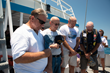 Submarine veterans honor lost shipmates at the site of the On Eternal Patrol Memorial Reef in May.