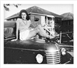 Current Texas Iron & Metal owner Max Reichenthal's mother sitting on the hood of the Chevrolet pick-up truck that started it all.