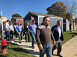 NASB CEO Paul Thomas tours VCP tiny village homes with employee veterans.