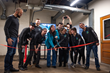 The VRpatients team cuts the ribbon to their new corporate headquarters in Columbus, Ohio.