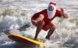 Everyone's Invited to Surf with Santa on Cocoa Beach this Christmas Eve