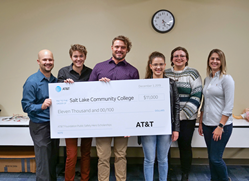 Students receive check for AT&T scholarship funds.