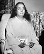 Paramahansa Yogananda in 1949 with a copy of his best-selling spiritual classic Autobiography of a Yogi.