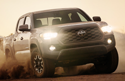 An image of the 2020 Toyota Tacoma driving through dust