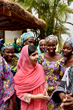 This photo taken by Tess Thomas for the Malala Fund shows how contagious her passion is as she visits with others who want an education.