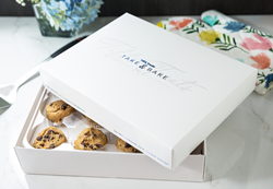 A white Tiff's Treats box sits partially open showing frozen chocolate chip cookie dough balls inside