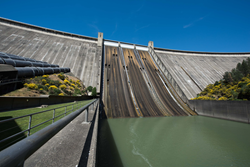 Shasta Dam in California, looking up at it from the river below.