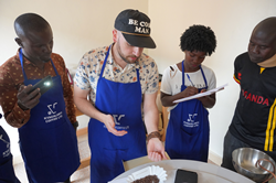 Crimson Cup's Brandon Bir cups coffee in Uganda