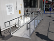Wheelchair ramp at entrance to immersive experience in large container at Universal City Walk.
