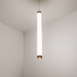 A luminous cylinder pendant with metal finishes and a downlight