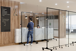 clear room dividers in front of a reception desk