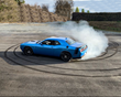 "Gray Leadbetter Racing celebrates National Police Week: Young racer delivers donuts in a Dodge Challenger and celebrates with a few ""donuts"" of her own"