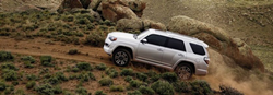A 2020 Toyota 4Runner driving on a dirt road
