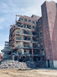 Expert crews are using machines to demolish the Clarence O. Cheney building at the $300 million Hudson Heritage development in the Town of Poughkeepsie, N.Y.