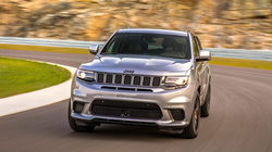 2020 Jeep Grand Cherokee gray driving around track with motion blur