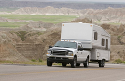 RAM pulling fifth-wheel camper