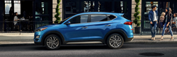 Blue 2020 Hyundai Tucson Side Exterior on a City Street