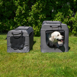 Dog and two PortablePET SoftCrate collapsible doghouses in the grass